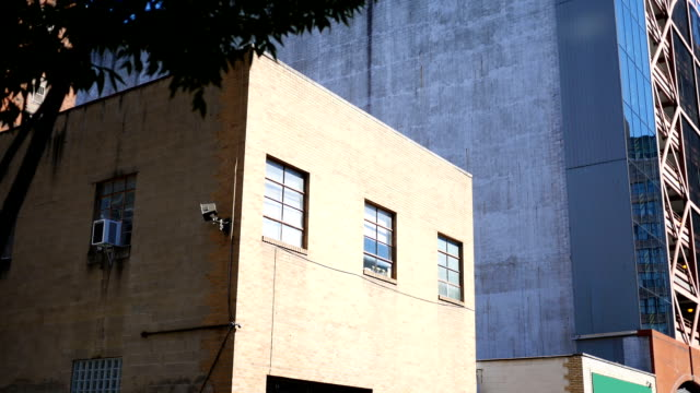 Establishing daytime shot of vacant foreclosed building in downtown city area video