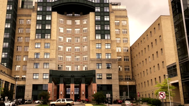 Establishing Evening shot of generic hospital building in downtown metropolian area video