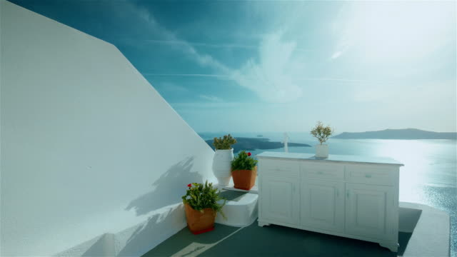 Establishing Shot of a Traditional Cycladic Mediterranean Terrace with Sea View video