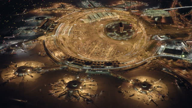 Establishing Shot of Airport at Night. With Terminals, Planes, Gates and Airport Lights. video