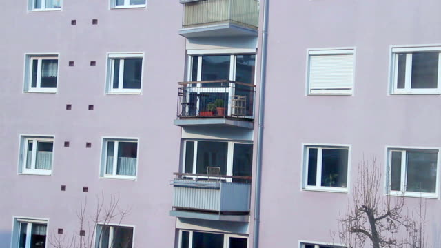 Establishing shot of apartment building at daytime, many windows video