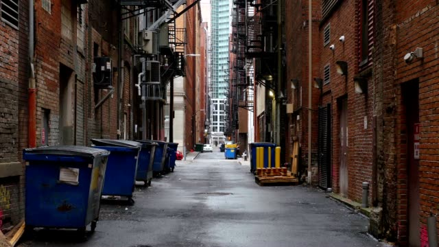 Establishing Shot of Empty Alleyway in a Large City A daytime overcast establishing shot of an empty alley in a big city. alley stock videos & royalty-free footage