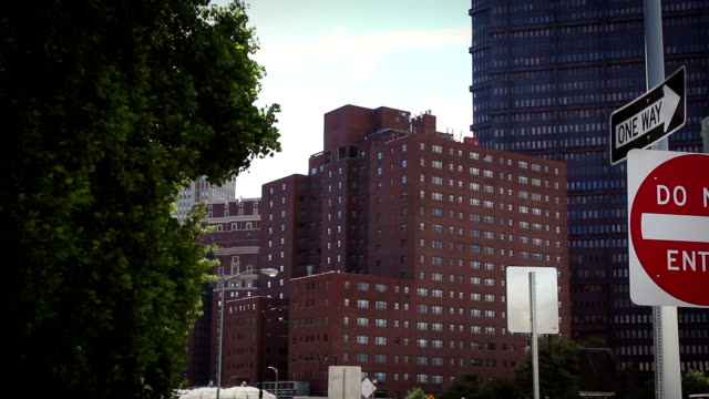 Establishing shot of generic hospital or office building in downtown city video
