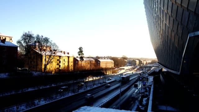 Establishing shot of Stockholm, car traffic and global arena video