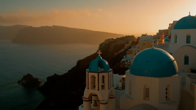 Establishing Wide Angle Shot of a Traditional Blue Dome Cycladic Church and the Aegean Sea video