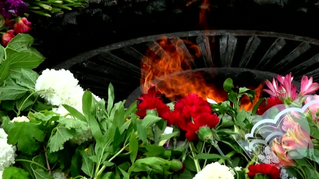 """""""Eternal Flame"""" at the memorial to fallen defenders the motherland """"Eternal Flame"""" at the memorial to fallen defenders the motherland,  victims for the victory may stock videos & royalty-free footage"""