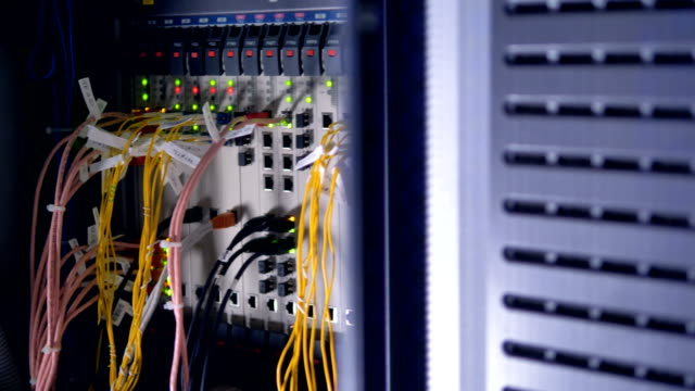 Ethernet cables inside a network cabinet. video