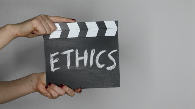vídeos de stock e filmes b-roll de ethics concept. hands holding movie clapper - moralidade