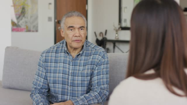 Ethnic adult senior male in a therapy session An african american adult male is sitting in a therapists office receiving counseling. baby boomers stock videos & royalty-free footage