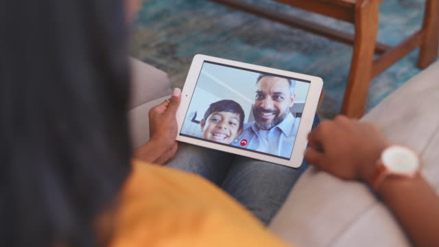 Ethnic couple with son making video call