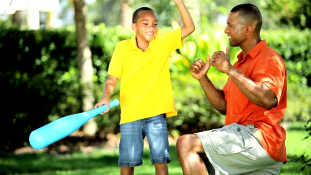 Ethnic Father & Son Practicing Baseball Swing video