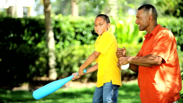 Ethnic Father Teaching Young Son Baseball video