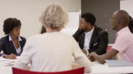 istock Ethnic Female Entrepreneur Pitching A Proposal to a Client 1166849205