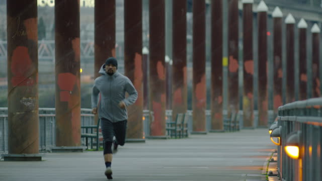 Ethnic male exercising/running outdoors video