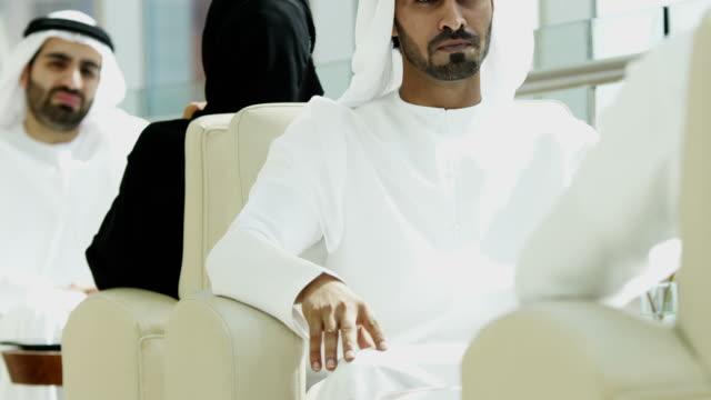 Ethnic male travellers wearing national dress Dubai hotel video