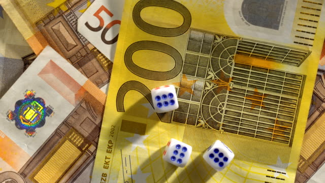 Euro Banknotes and dice