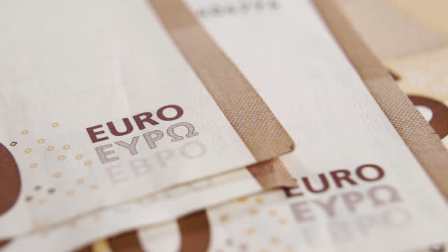 Euro banknotes are falling in slow motion