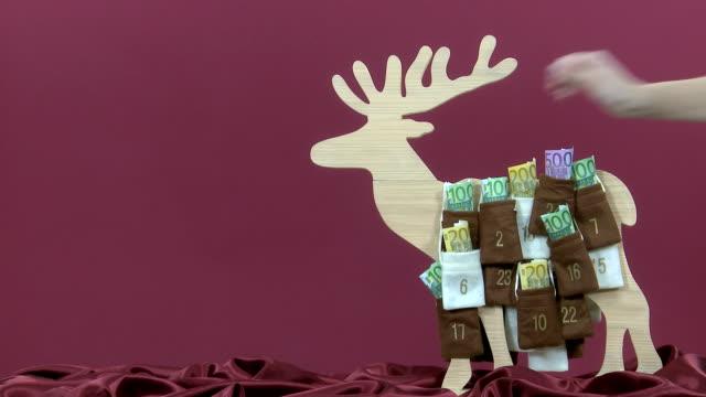 euro geldscheine im advent calendar - advent stock-videos und b-roll-filmmaterial