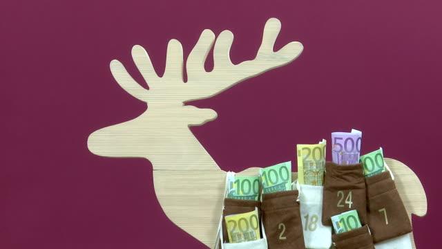 Euro bills in Advent Calendar video