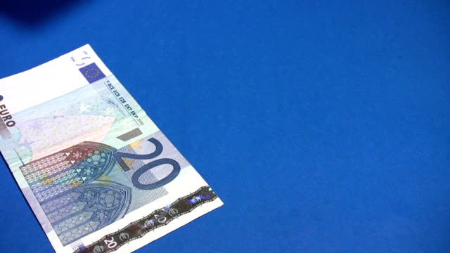 Euro cash money on blue background video