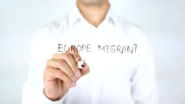 Europe Migrant Crisis, Man Writing on Glass video