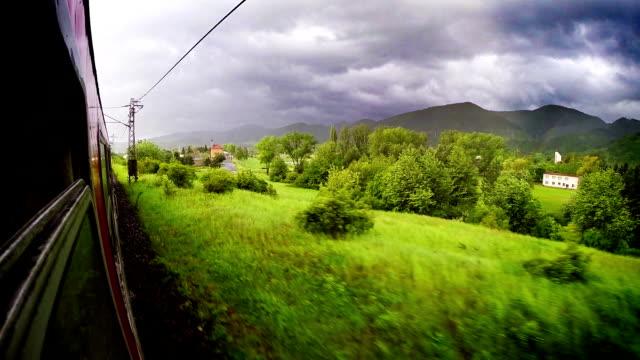 europe train wide angle tatra mountains view out the window - karpaterna tåg bildbanksvideor och videomaterial från bakom kulisserna
