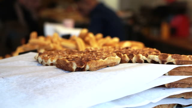 European crispy waffle selling in Amsterdam European crispy waffle selling in Amsterdam pastry dough stock videos & royalty-free footage