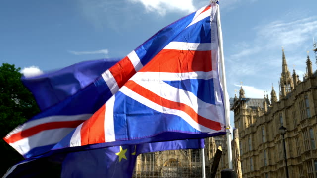 european flag with union jack in front of westminster - england stock videos & royalty-free footage