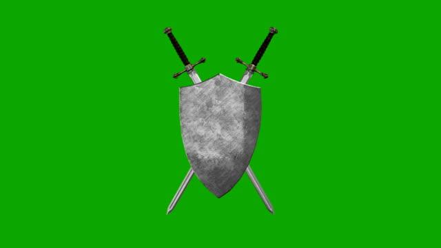 vídeos y material grabado en eventos de stock de espadas europeas y el escudo formando un símbolo de espadas y el escudo formando un símbolo sobre un fondo de pantalla verde - shield