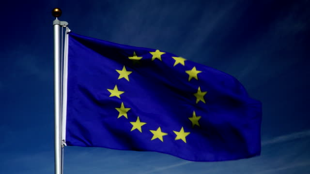4K: European Union Flag on Flagpole in front of Blue Sky outdoors (EU) video