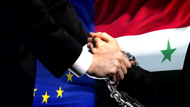 European Union sanctions Syria, chained arms, political or economic conflict European Union sanctions Syria, chained arms, political or economic conflict damascus stock videos & royalty-free footage