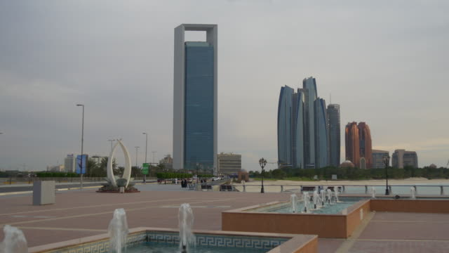 evening abu dhabi marina fountain downtown towers panorama 4k united arab emirates - uae national day стоковые видео и кадры b-roll