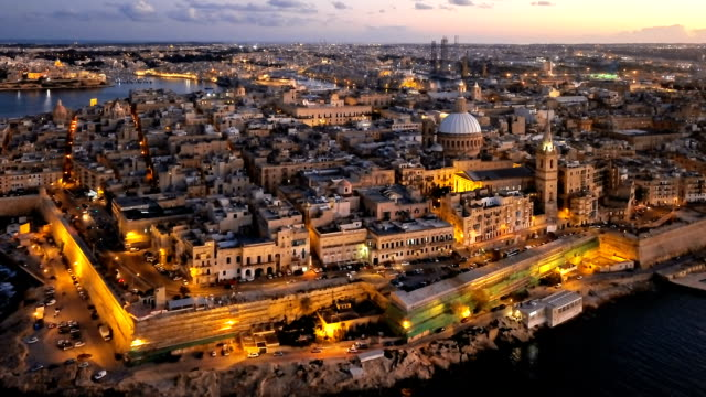 Evening aerial hyper lapse of Valletta old town, Malta Night aerial hyperlapse of Valletta, Malta malta stock videos & royalty-free footage