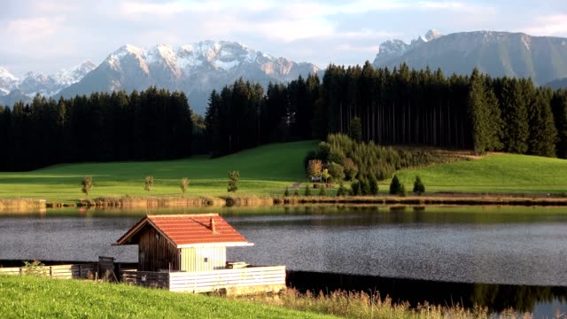 Evening at the lake with mountains, Attlesee, Nesselwang, Allgäu, Alpen, Bayern, 4K video