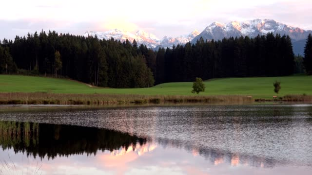 Evening at the lake with mountains, reflection, mirror image, Attlesee, Nesselwang, Allgäu, Alpen, Bayern, 4K video