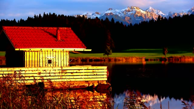 Evening at the lake with mountains, Videoeffect, Attlesee, Nesselwang, Allgäu, Alpen, Bayern, 4K video