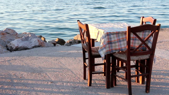 Evening at traditional Greek tavern, restaurant by the open sea video