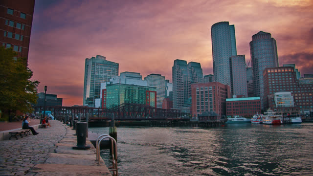 Evening Boston. Riverside. Business Downtown. Financial Building. Sunset.