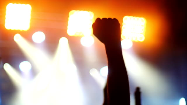 Evening concert. Crowd. Rising fist sign gesture. 50 fps Evening concert. Crowd. Rising fist sign gesture. 50 fps 4k rock music stock videos & royalty-free footage