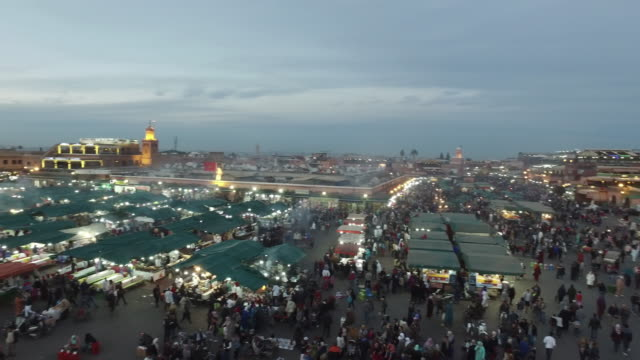 evening djemaa el fna square with koutoubia mosque, marrakech, morocco - souk video stock e b–roll
