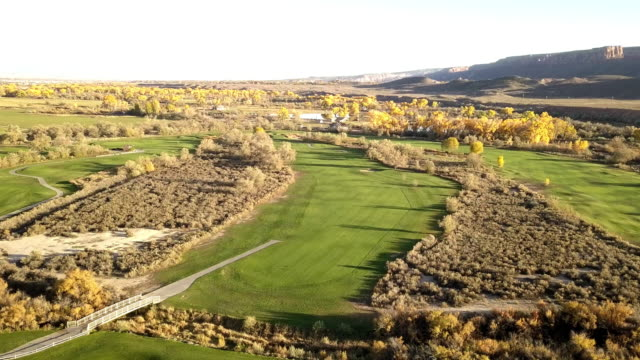 Evening Drone Footage of Luxury Golf Course at Dusk in the Fall
