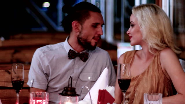 evening for lovers, loving couple in the restaurant, Valentine's Day, romantic date, boys and girls in a romantic atmosphere in the cafe, beautiful table setting video
