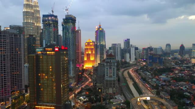 evening illumination kuala lumpur downtown traffic road aerial panorama 4k malaysia - kuala lumpur video stock e b–roll