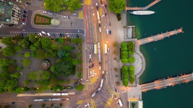 vídeos de stock e filmes b-roll de evening illumination zurich center riverside traffic square down view aerial panorama 4k time lapse switzerland - suíça