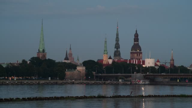 evening in historical center of old riga - peter the apostle video stock e b–roll
