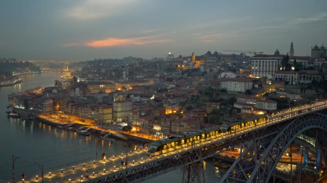 Evening Porto with Dom Luis I Bridge over Douro river. People walking along the illuminated bridge. Panoramic shot. Evening Porto with Dom Luis I Bridge over Douro river. People walking along the illuminated bridge. Panoramic shot. portugal stock videos & royalty-free footage