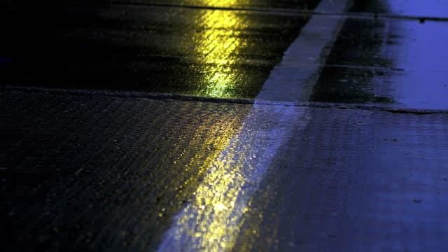Evening rain drips onto the concrete surface video