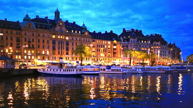 Evening scenery of Stockholm, Sweden Scenic summer evening panorama of the Old Town (Gamla Stan) architecture pier in Stockholm, Sweden stockholm stock videos & royalty-free footage