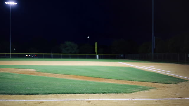 Evening shot of empty baseball field.  Some lightning in the sky. video