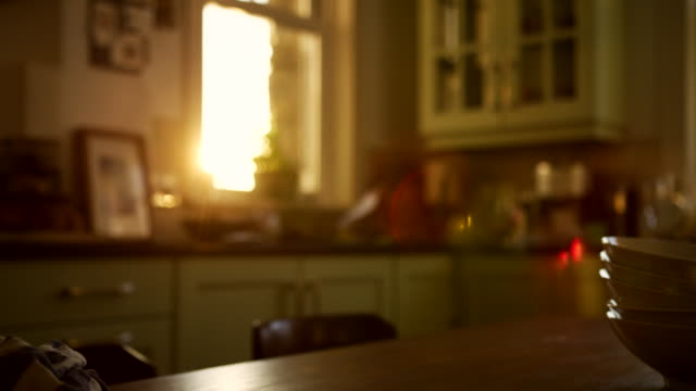evening sunlight streaming into kitchen - kitchen room video stock e b–roll